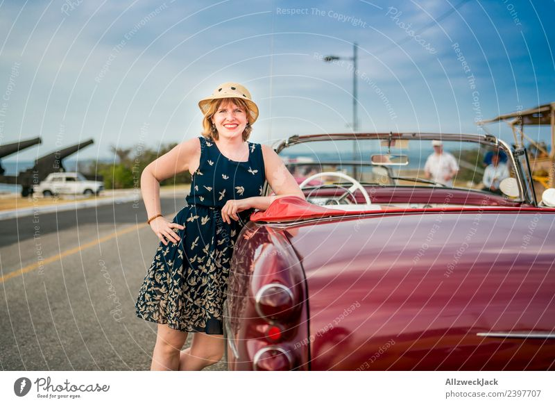 Portrait of a woman with a blue dress and a hat on a vintage car Cuba Havana Island Vacation & Travel Travel photography Trip Sightseeing Vintage car