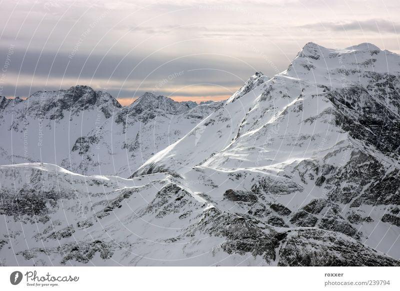 Mountain in winter Vacation & Travel Tourism Winter Snow Winter vacation Environment Nature Landscape Sky Clouds Hill Alps Peak Glacier White sierra rock Alpine