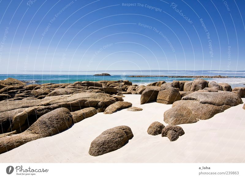 the art of travel Nature Landscape Elements Sand Water Sky Cloudless sky Horizon Sunlight Climate Beautiful weather Rock Coast Beach Ocean Stone Exotic Blue