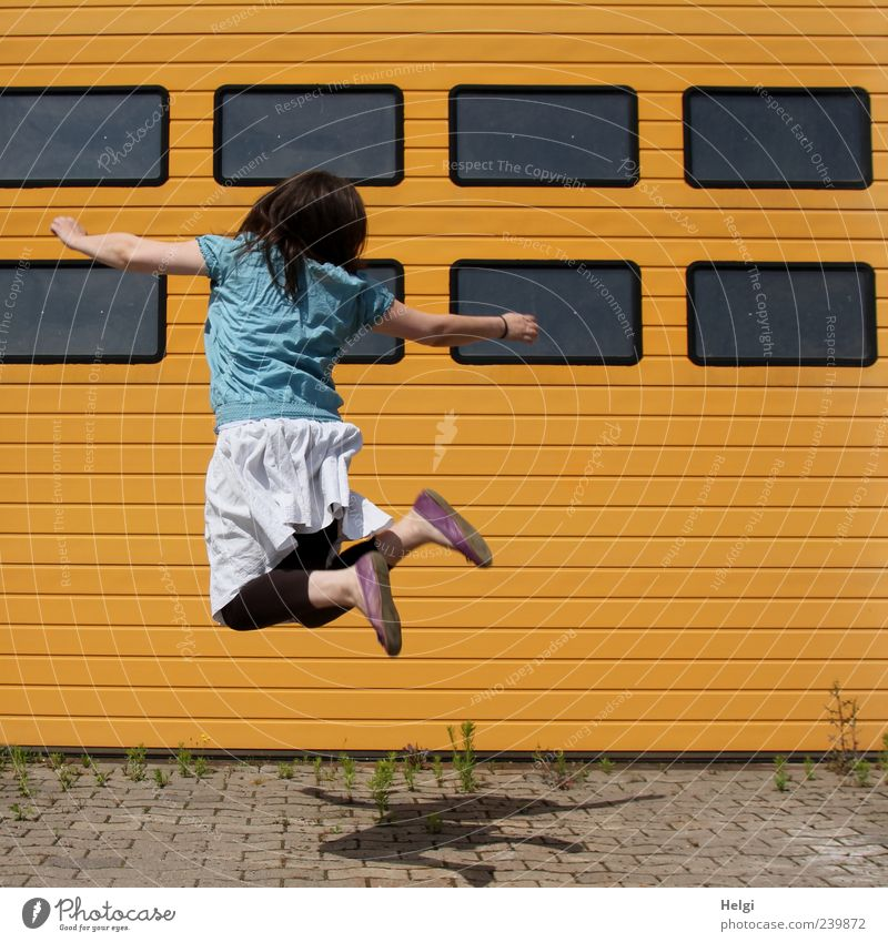 Human being Woman Youth (Young adults) Blue White Adults Yellow Window Life Movement Hair and hairstyles Young woman Gray Jump Stone Building