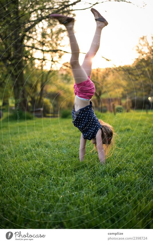 Girl does handstand Joy Happy Healthy Athletic Fitness Wellness Life Harmonious Well-being Garden Sports Training Child School Infancy Environment Nature Sky