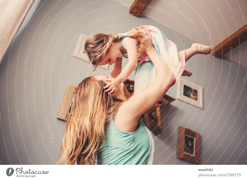 mother and toddler girl playing at home Lifestyle Sofa Modern interior room Toddler Playing Mother Home Happy Family & Relations Morning