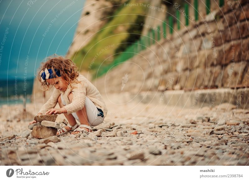 child girl playing with stones on the beach Joy Happy Beautiful Playing Vacation & Travel Summer Beach Ocean Child Sky Coast Stone Smiling Sit Small Cute Blue