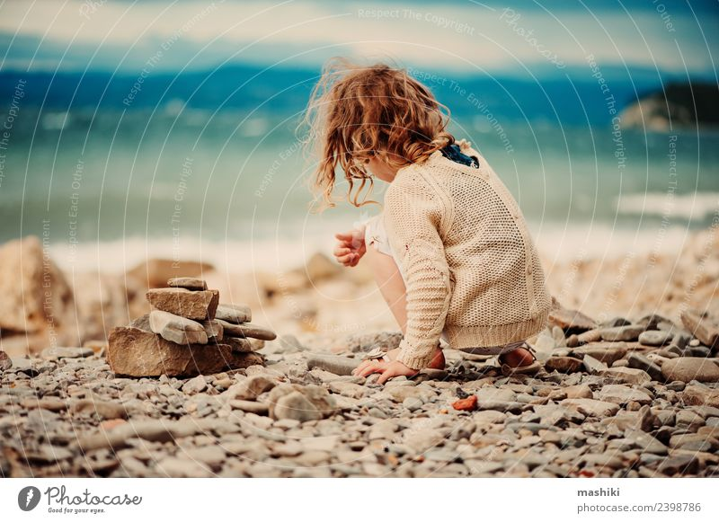 child girl playing with stones on the beach Child Sky Vacation & Travel Blue Summer Beautiful White Ocean Joy Beach Coast Happy Small Playing Stone Europe
