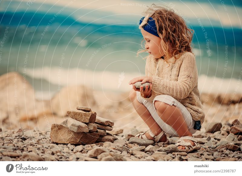 child girl playing with stones on the beach Lifestyle Leisure and hobbies Vacation & Travel Summer Summer vacation Sun Beach Ocean Child Girl 3 - 8 years