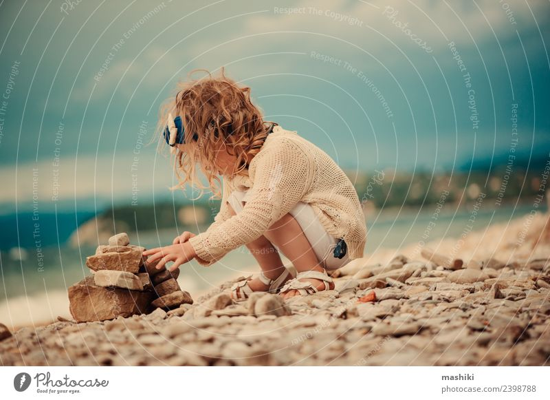 child girl playing with stones on the beach Joy Beautiful Playing Vacation & Travel Summer Beach Ocean Child Sky Clouds Rock Aircraft Stone Sit Small Cute Blue