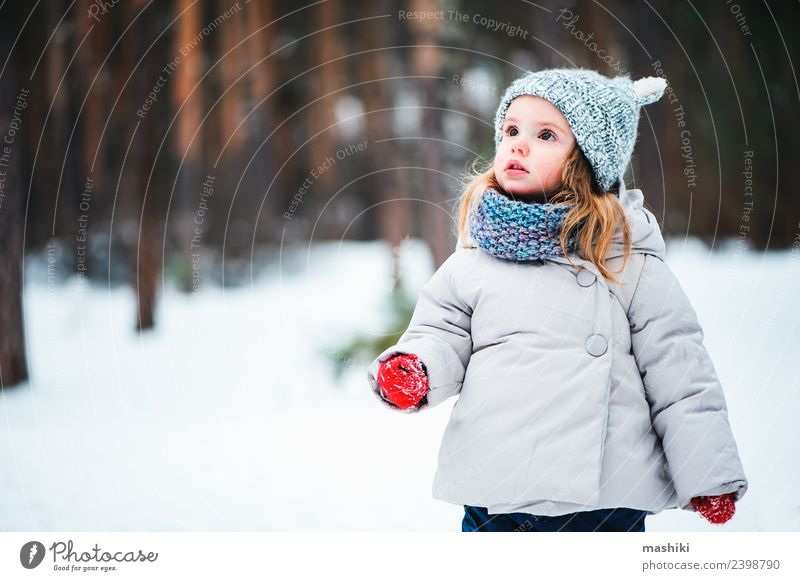baby girl in knitted hat walking in winter forest Lifestyle Joy Beautiful Face Playing Vacation & Travel Winter Snow Child Baby Toddler Infancy Weather Tree