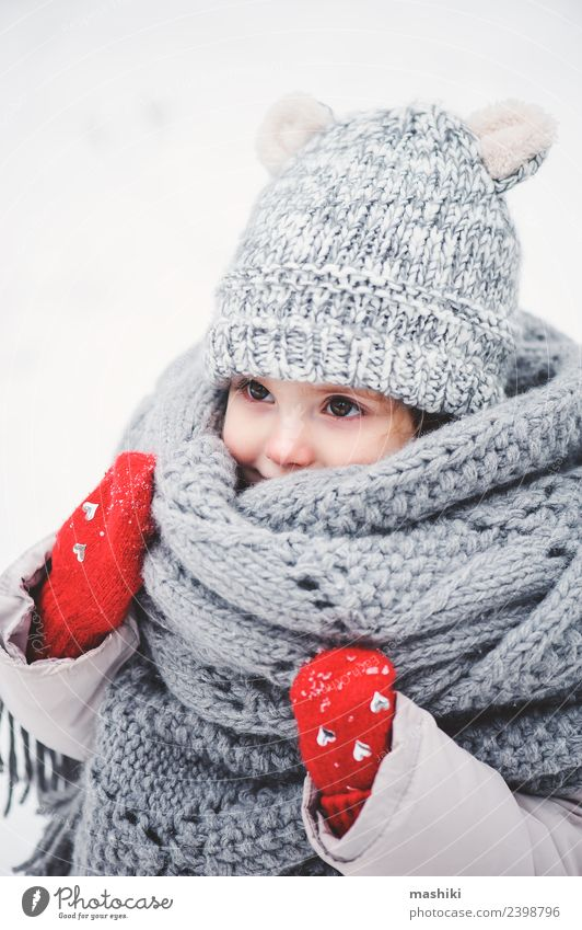 cute baby girl in knitted scarf walking in winter Lifestyle Joy Vacation & Travel Winter Snow Child Baby Toddler Infancy Weather Forest Fashion Coat Scarf Hat