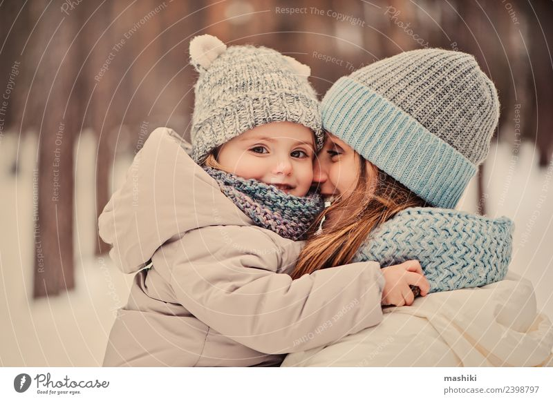 mother walking with daughter in winter Lifestyle Joy Beautiful Playing Vacation & Travel Winter Snow Child Baby Toddler Woman Adults Infancy Weather Forest Coat