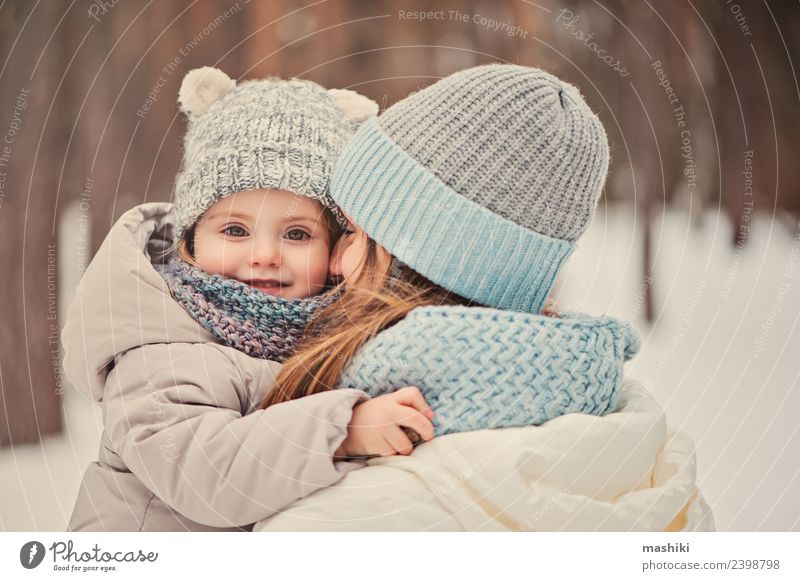 happy family on winter walk Child Vacation & Travel Tree Joy Winter Forest Adults Lifestyle Love Snow Family & Relations Laughter Playing Together Friendship