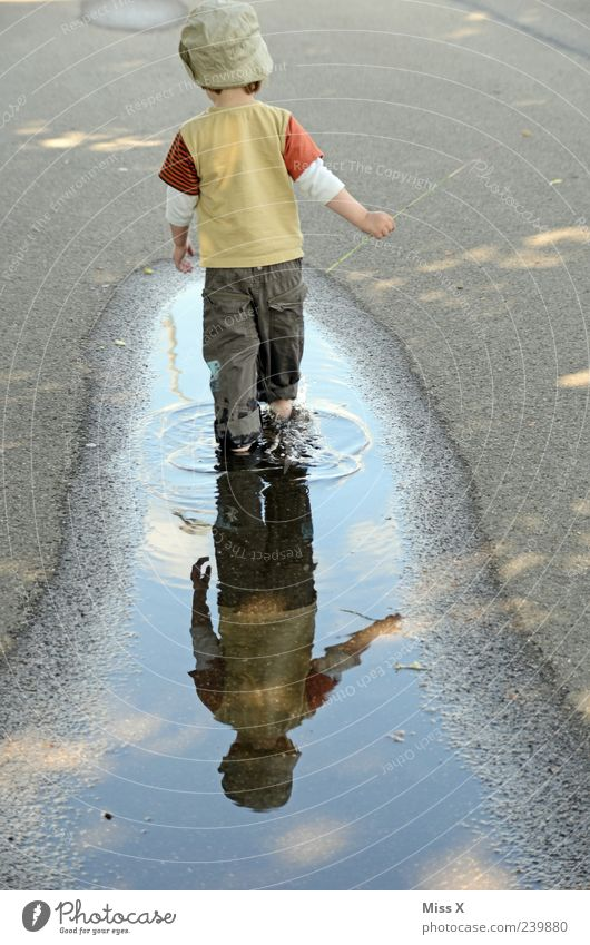 Human being Child Water Joy Street Playing Lanes & trails Funny Rain Weather Infancy Dirty Walking Wet Toddler Cap