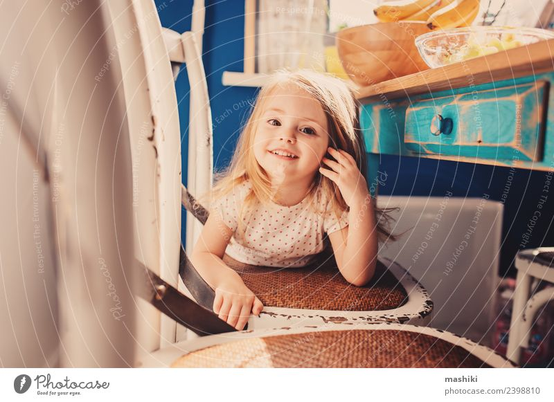 happy toddler girl in pyjamas playing in kitchen Child Beautiful White Joy Lifestyle Funny Laughter Happy Small Playing Modern Blonde Smiling Baby Cute Kitchen