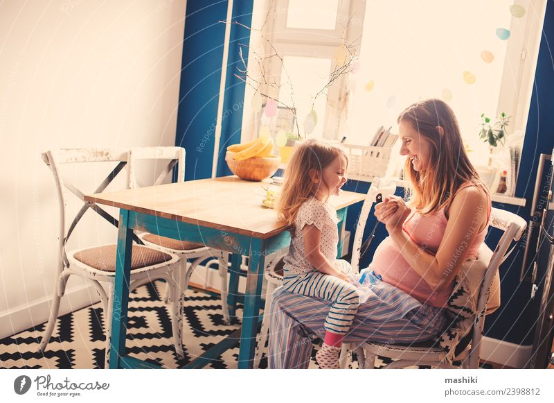 happy toddler girl playing with pregnant mother Breakfast Tea Kitchen Child Baby Toddler Parents Adults Mother Sister Family & Relations Friendship Smiling Love
