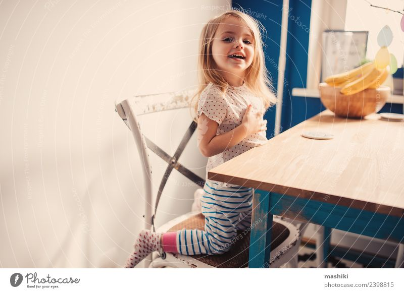 happy toddler playing in kitchen Breakfast Lifestyle Joy Happy Beautiful Face Playing Kitchen Child Baby Toddler Smiling Laughter Sit Happiness Small Modern