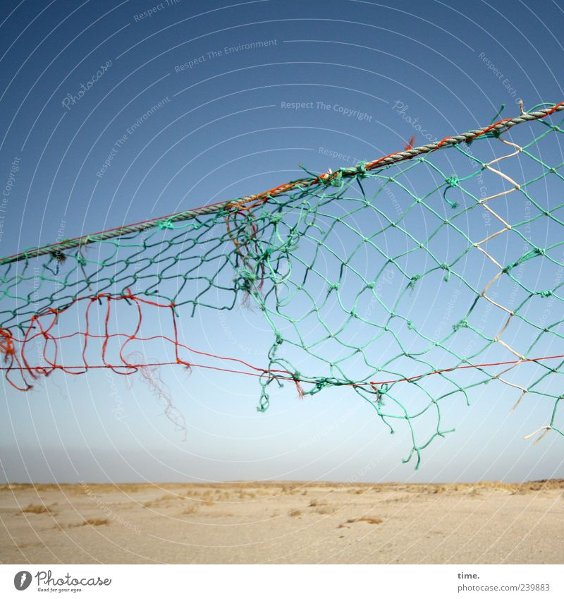 Spiekeroog | Battlefield Beach Sand Sky String Net Old Tall Broken Volleyball net Torn Defective Diagonal Gust of wind Shabby Worn out Derelict Weathered