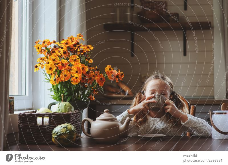 child girl having breakfast at home Breakfast Tea Lifestyle Happy House (Residential Structure) Decoration Chair Table Kitchen Child Family & Relations Autumn