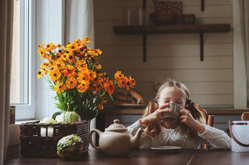 child girl having breakfast at home Child Flower House (Residential Structure) Warmth Lifestyle Autumn Family & Relations Happy Gray Decoration Modern Sit Table