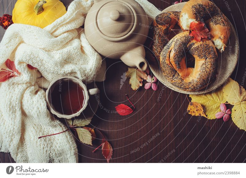 top view of cozy autumn breakfast on table Breakfast Beverage Tea Pot Lifestyle Decoration Table Autumn Leaf Sweater Safety (feeling of) Comfortable fall Bagel