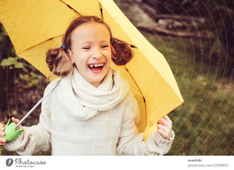 happy kid girl hiding under umbrella Lifestyle Joy Happy Playing Knit Garden Child Infancy Nature Autumn Weather Rain Park Sweater Drop Funny Wet Cute Yellow