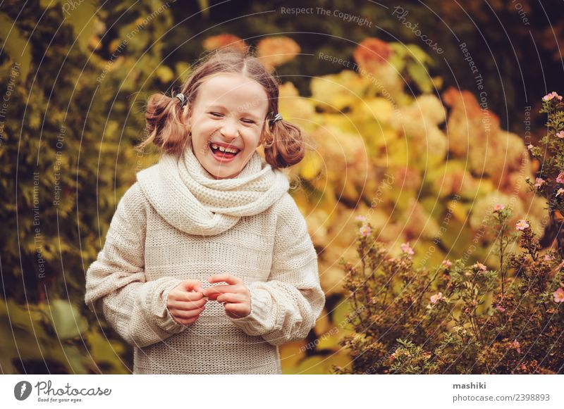 happy kid girl playing in autumn garden Joy Happy Playing Knit Vacation & Travel Garden Child Work and employment Nature Autumn Warmth Flower Leaf Sweater Scarf