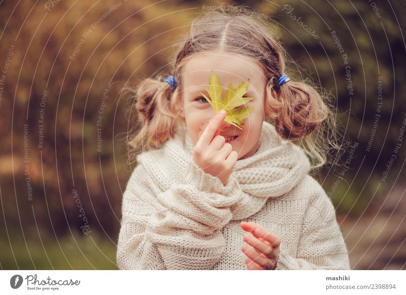 kid girl playing with autumn maple leaf Child Nature Vacation & Travel Flower Leaf Joy Warmth Autumn Funny Natural Happy Playing Garden Work and employment