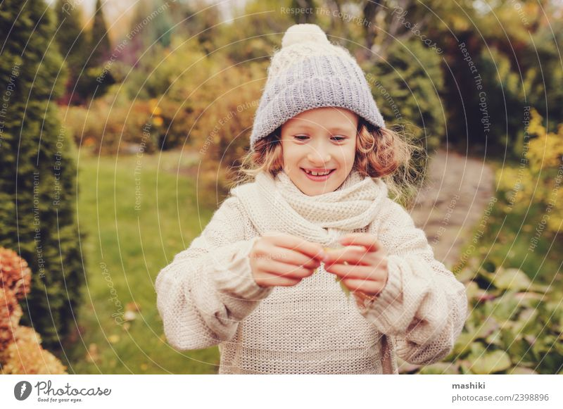 cute happy kid girl playing on autumn walk Child Nature Vacation & Travel Flower Leaf Joy Warmth Autumn Funny Natural Playing Garden Work and employment Action