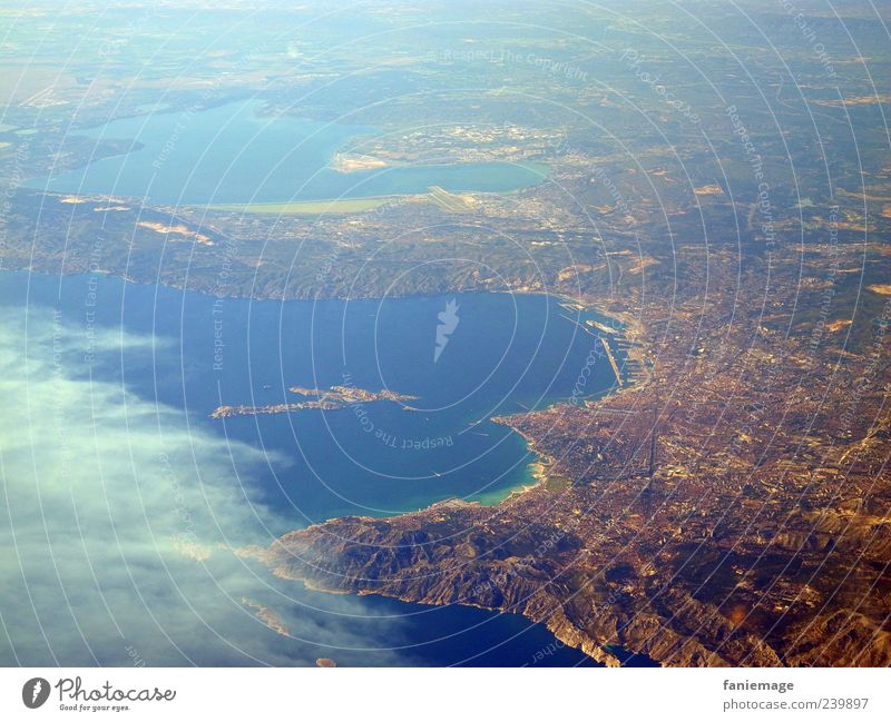 home flight Landscape Earth Sky Mountain Coast Ocean Port City View from the airplane Flying Blue Brown Uniqueness Far-off places Colour photo Aerial photograph