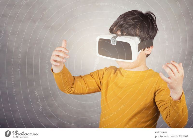 boy playing with virtual reality glasses on gray background Lifestyle Joy Playing Hardware Technology Entertainment electronics Science & Research Advancement