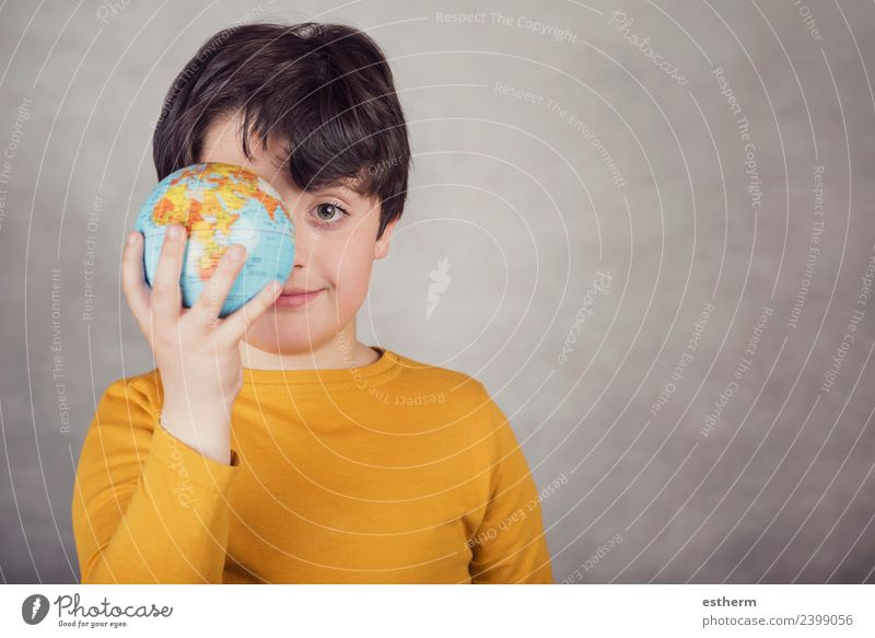 smiling boy with a earth globe covering his eye Joy Vacation & Travel Tourism Trip Adventure Human being Masculine Child Toddler Infancy 1 8 - 13 years Sphere