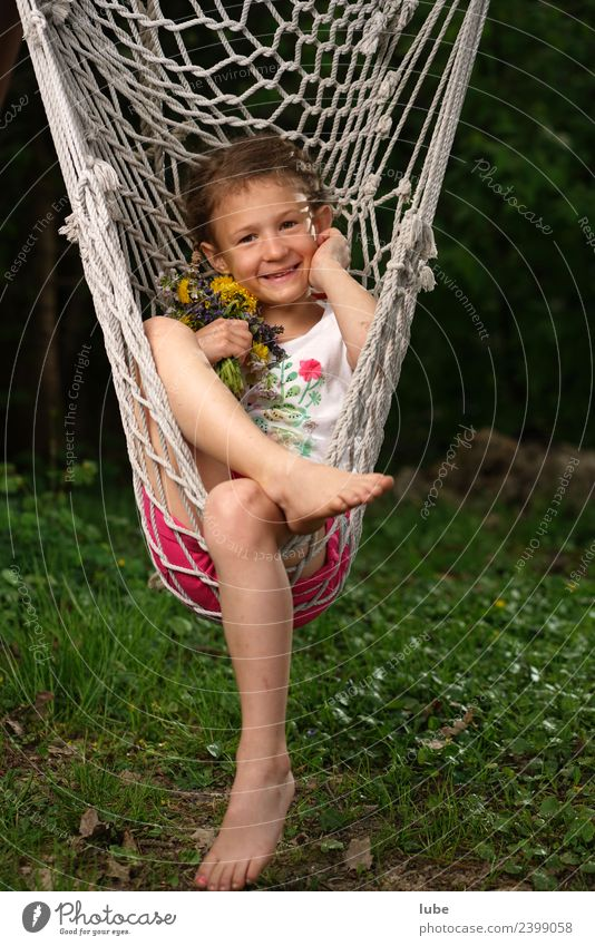 hammock Wellness Harmonious Well-being Contentment Relaxation Calm Girl 1 Human being 3 - 8 years Child Infancy Spring Garden Park Hang Hammock Colour photo