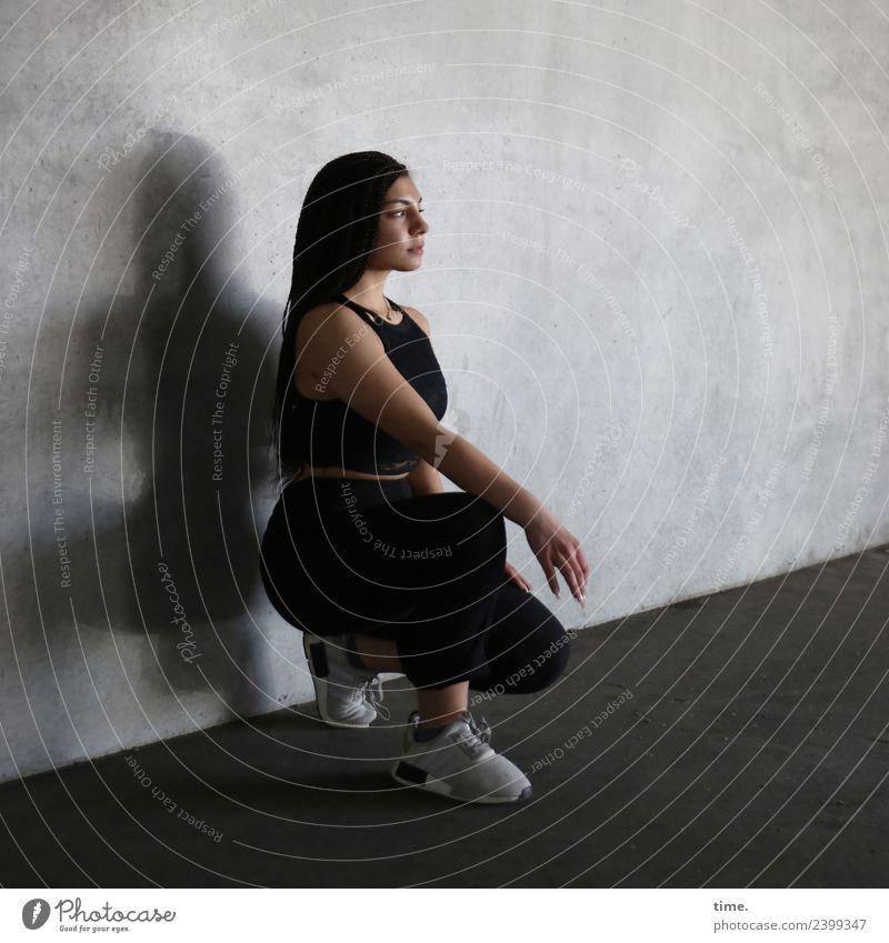Nikoliya Sports Feminine Woman Adults 1 Human being Wall (barrier) Wall (building) T-shirt Pants Sneakers Brunette Long-haired Observe Crouch Looking Wait Dark