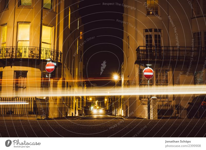 One-way street on beach promenade, Brighton, England Esthetic Background picture Dark Light Night mood Night shot Structures and shapes Colour photo