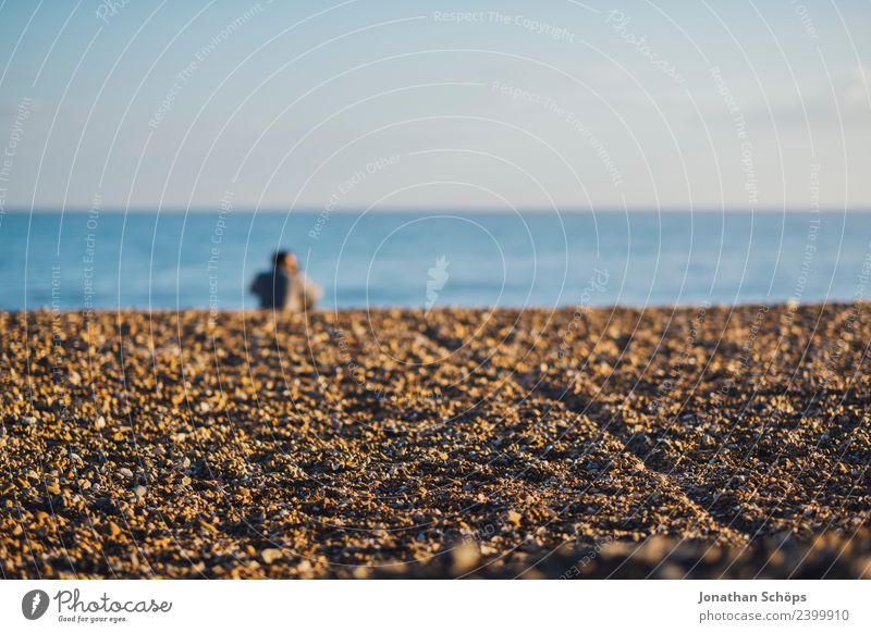 Couple sitting on the beach Partner 2 Human being Nature Sky Cloudless sky Waves Coast Beach Ocean Pebble beach Brighton Great Britain Europe Port City Touch