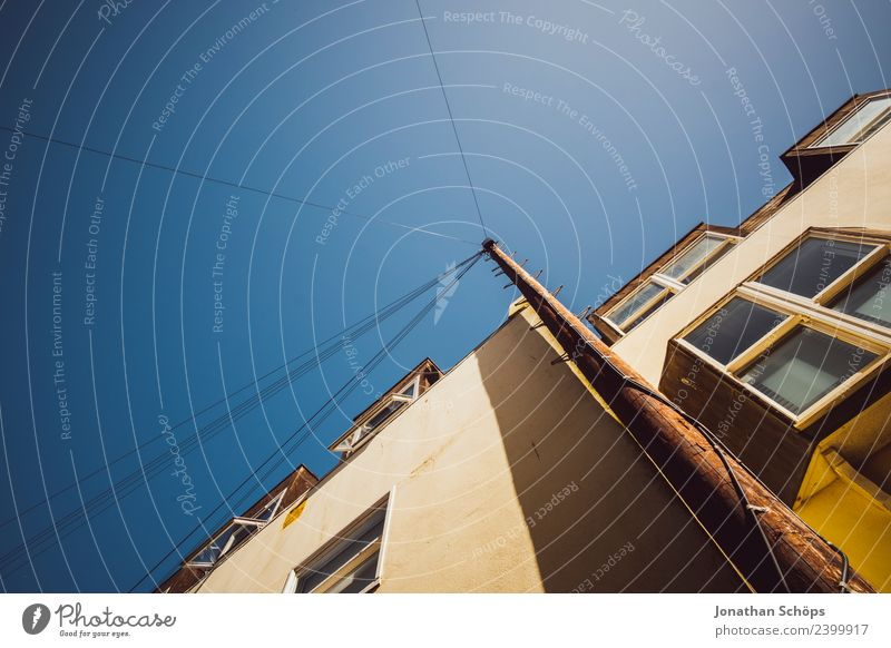 Above the roofs VII Sky Cloudless sky Sun Brighton Great Britain Europe Town Port City House (Residential Structure) Facade Window High voltage power line Blue