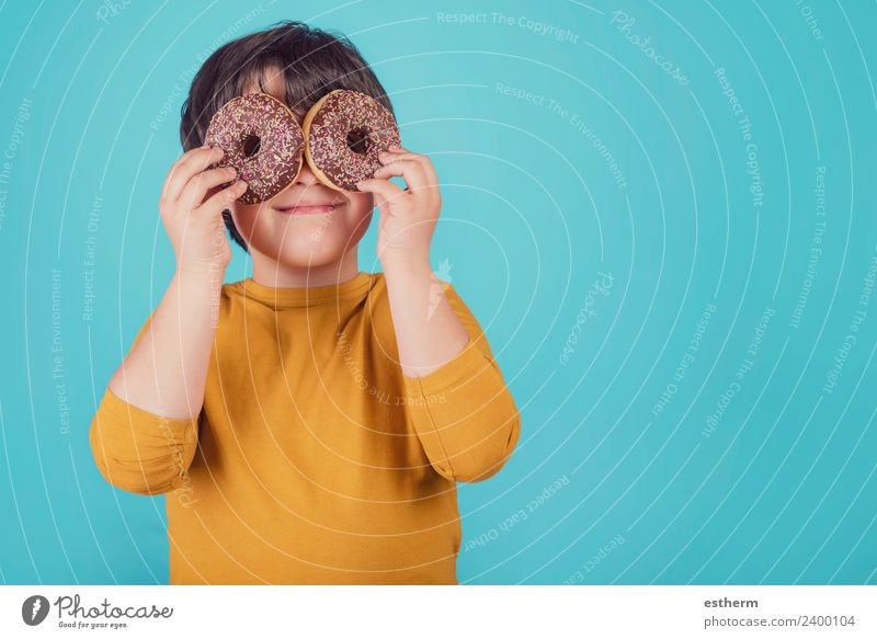 smiling boy holding donuts over her eyes Child Human being Lifestyle Funny Happy Playing Food Masculine Nutrition Infancy Smiling Happiness Sweet Round