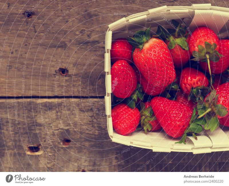 Delicious strawberries in a basket Fruit Dessert Organic produce Vegetarian diet Diet Healthy Eating Summer Nature Red ripe rustic strawberry sweet table tasty