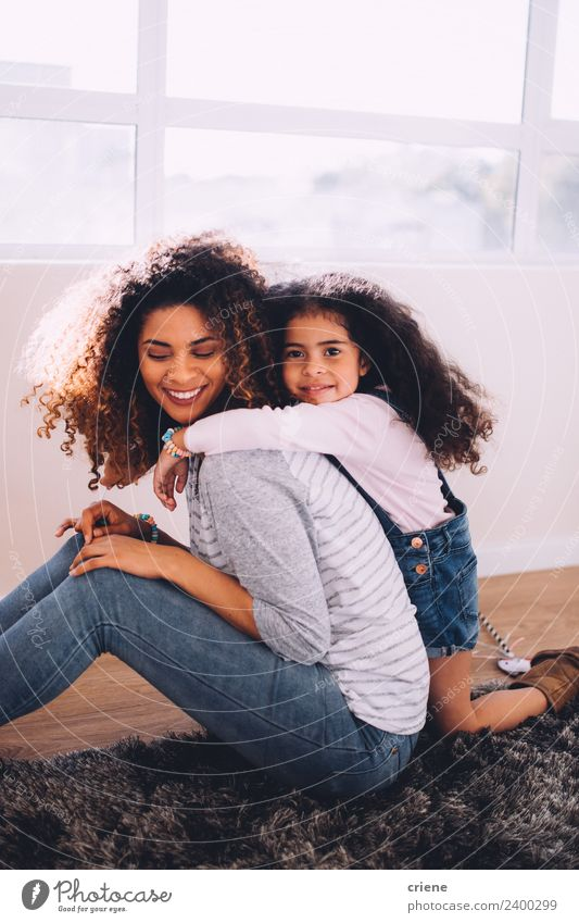 african daughter hugging her mom at home Woman Child Beautiful House (Residential Structure) Adults Life Love Family & Relations Happy Infancy Smiling Happiness
