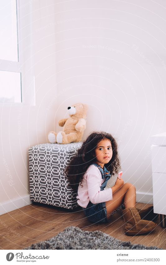 African girl sits next to her teddy bear at home Happy Beautiful Child Boots Toys Teddy bear Sit Small Cute Bear Home room kid background window Carpet african