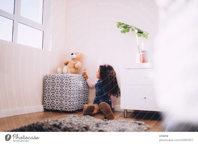 afrcian girl giving teddy sweets at home Happy Beautiful Playing Child Boots Toys Teddy bear Sit Small Cute Bear Home room kid background window Carpet african