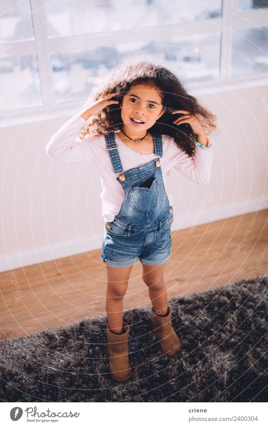african little girl standing on carpet at home Happy Beautiful Child Infancy Stand Small Cute Loneliness Home American Delightful hair Horizontal kid Curly