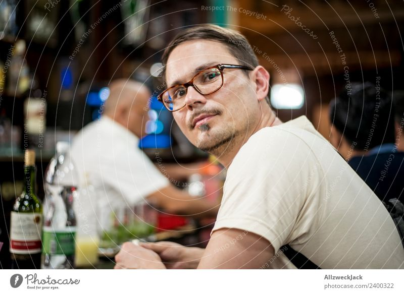 Portrait young man with glasses at a bar Cuba Havana Bar Young man Eyeglasses Person wearing glasses Forward Contentment Dreamily Meditative Observe Think