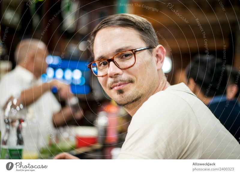 Portrait young man with glasses at a bar Cuba Havana Bar Young man Eyeglasses Person wearing glasses Looking into the camera Contentment Smiling