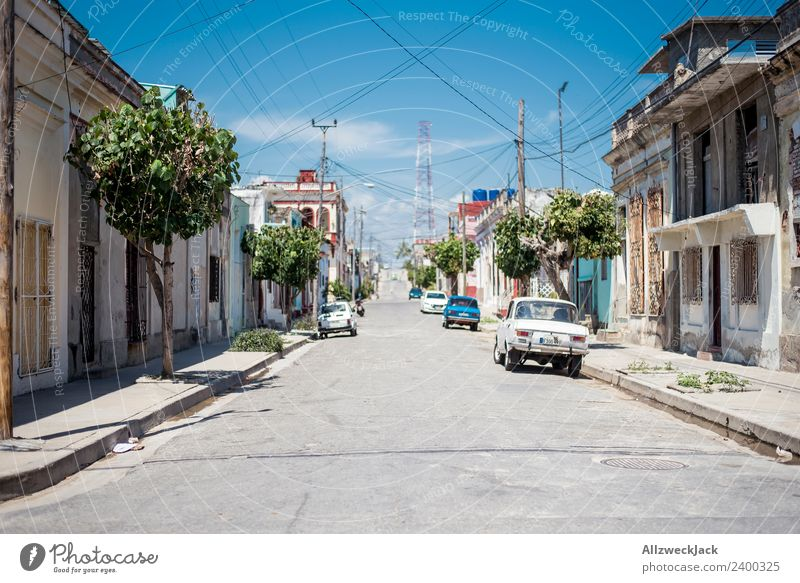 Midday sun on the streets of Cienfuegos Cuba Vacation & Travel Travel photography Street Town Deserted Vintage car Parking Car Summer Blue sky Hot Gloomy