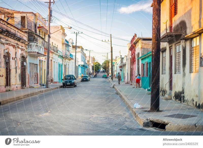 Midday sun on the streets of Cienfuegos Cuba Vacation & Travel Travel photography Street Town Deserted Vintage car Parking Car Summer Blue sky Clouds Pole