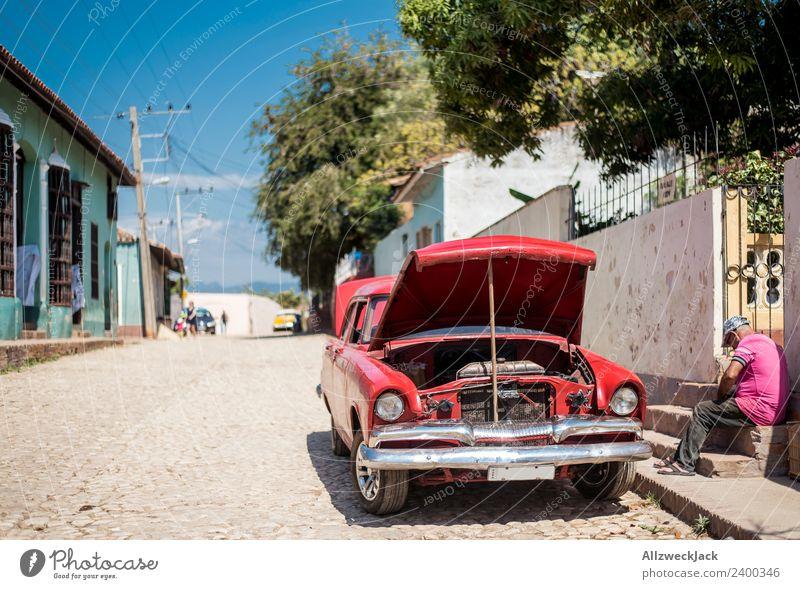 Man repairs his oldtimer at the roadside Cuba Trinidade Patriotism Socialism Vacation & Travel Travel photography Wanderlust Vintage car 1 Person Sit Blue sky