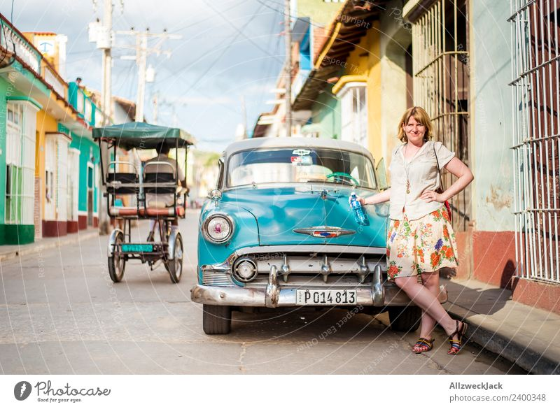 Vacation & Travel Young woman Summer Travel photography Street Warmth Car Stand Posture Wanderlust Cuba Passenger traffic Blue sky Motor vehicle Vintage car
