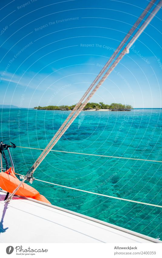 View of a small island in the Caribbean from the boat Day Deserted Island Paradise Clarity Gorgeous Water Ocean Sailing Sailboat Maritime Blue sky Cloudless sky
