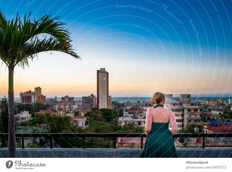 Woman on terrace with view over Havana in Cuba Panorama (View) Sunset Summer Card Vacation & Travel Dusk Vantage point Skyline Palm tree Island