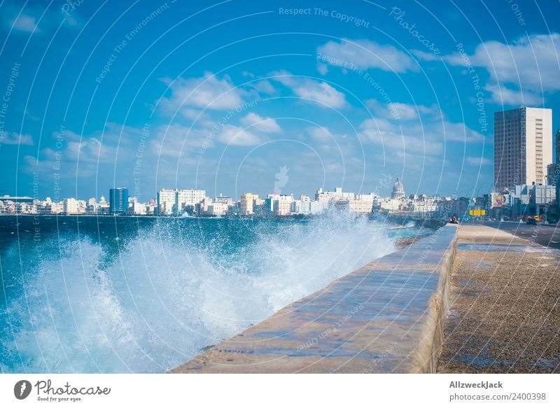 Skyline and spray at the Malecon in Havana Day Summer Blue sky Cuba El Malecón Ocean Water Waves White crest Promenade Coast House (Residential Structure)