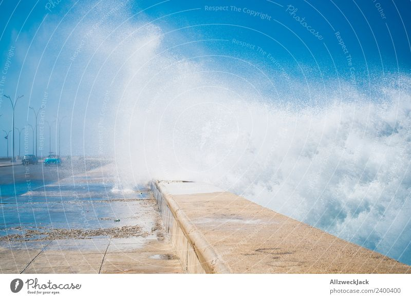 Spray at the Malecon in Havana Day Summer Blue sky Cuba El Malecón Ocean Water Waves White crest Promenade Coast Skyline Clouds Vacation & Travel